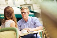Handsome blond in a discussion with girlfriend Stock Photos