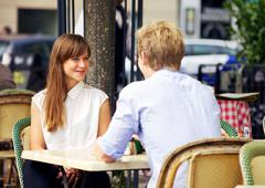 dating couple in a parisian cafe - stock photo