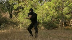 Nunchuck ninja turns in the woods Stock Footage