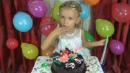 Child's Birthday, Little Girl's Licking Chocolate from Cake at her Party Stock Footage