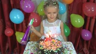 Child's Birthday, Little Girl Blowing Out Candles at her Party Stock Footage