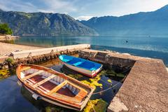 a small bay with boats - stock photo