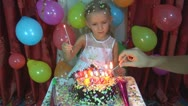 Child's Birthday, Lighting Candles for Little Girl's Party Stock Footage