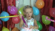 Little Girl Blowing in a Blower at Her Party, Child's Birthday Stock Footage