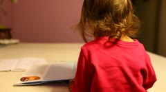 Girl Toddler Reads Dictionary Stock Footage