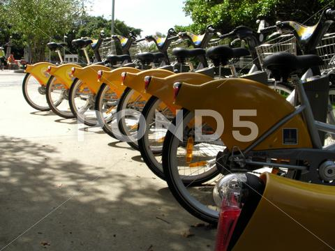 Stock photo of Rental commuter bicycles lined up in a bike rack