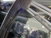 Retro steering wheel close up with out of focus gauges in a Land Rover Series II Stock Photos