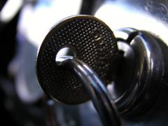 Retro key in ignition close up - stock photo