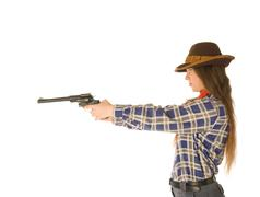 An isolated photo of a cowgirl with a gun Stock Photos