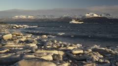 Alaskan Fishing Trawler in Icy Seas with Kenai Mountains Stock Footage
