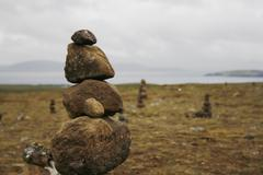 Tower of balanced rocks in wild landscape Stock Photos