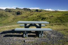 wooden bench in beautiful landscape - stock photo