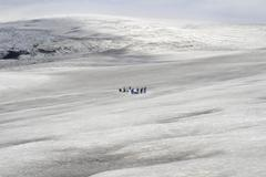 people on glacier - stock photo