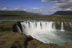 godafoss waterfall, iceland. with rainbow. - stock photo