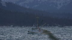 Ice-Encrusted Fishing Boat in Alaska Steaming By in Wind and Waves Stock Footage