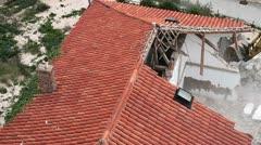 Excavator demolishing house Stock Footage