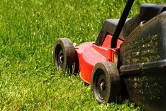 Lawnmower on grass Stock Photos