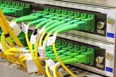 sc connectors in patch panel - stock photo