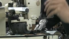 Textile Garment Factory Workers: ECU jeans sewing machine, prep and sew Stock Footage