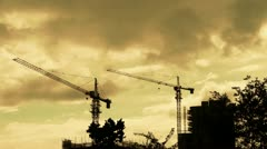 Construction-cranes,clouds cover sky,building high-rise,House silhouette. Stock Footage