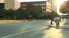 TIMELAPSE BUSY DOWNTOWN INTERSECTION WITH LENS FLARE Stock Footage