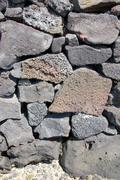 detail, dry built lava stone wall - stock photo