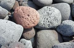 lava rocks, rounded by the ocean - stock photo