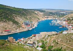 seafront with ships at pier (balaclava town, crimea, ukraine) - stock photo