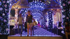 People walking under bright Christmas Lights Decoration Timelapse - stock footage