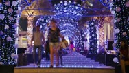 People walking under bright Christmas Lights Decoration Timelapse Stock Footage