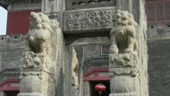 Stock Video Footage of China stone arch & stone lions in front of ancient city gate.