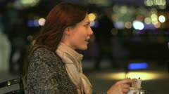 Attractive couple on a date together in the city at night Stock Footage
