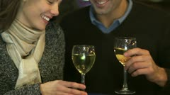 Young couple in love drinking wine on an open air terrace in the city - stock footage