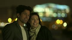 Romantic couple spending time together in the city at night Stock Footage