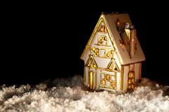 little toy house covered with artificial snow. - stock photo