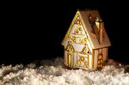 Little toy house covered with artificial snow. Stock Photos