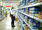 Woman in the supermarket. kid's food. Stock Photos
