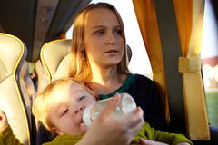 mother with kid in the bus. - stock photo