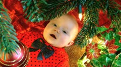 Baby under christmas tree happy 2 Stock Footage