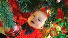 Baby under christmas tree laughing Stock Footage