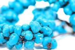 blue bracelet on white background - stock photo