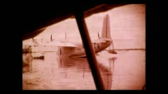 "Leaving the Imperial Airways flying boat ""Coriolanus"" for breakfast ashore 1937 - stock footage"