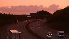 Traffic on the A1/M motorway at sunset Leeds Yorkshire United Kingdom Stock Footage