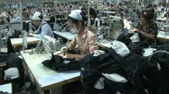 Textile Garment Factory Workers: Dolly type move along aisles of workers Stock Footage