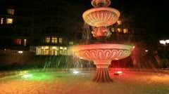 Obsolete colored fountain in the park - stock footage