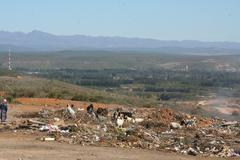Dumpyard at township - stock photo
