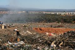 Dumpyard at township Stock Photos