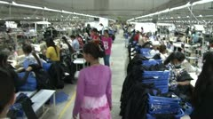 Stock Video Footage of Textile Garment Factory Workers: High angle move with supervisor through aisles