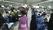 Stock Video Footage of Textile Factory Workers: High angle move with supervisor through aisles