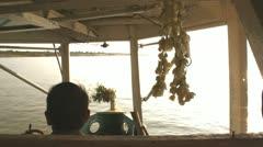 Rear view of a man enjoying a boat ride on Ayeyarwady River, Burma Stock Footage